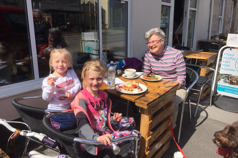children-dining-outside-white-stones-art-cafe-gallery-portland-dorset.jpg