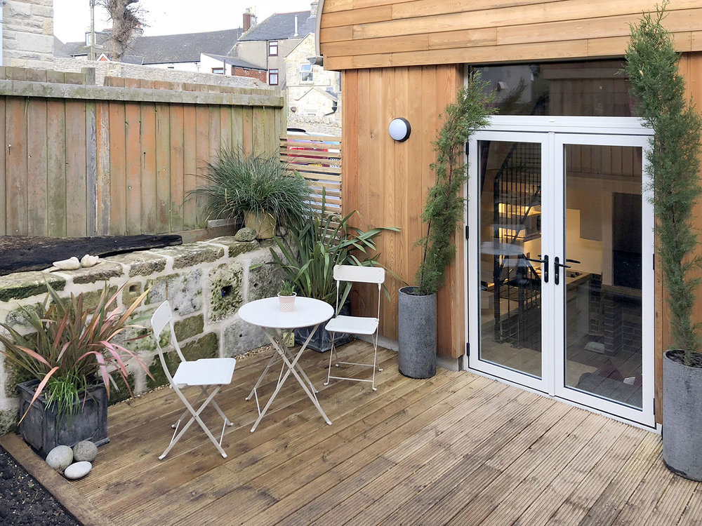 private patio area in our eco studio retreat accommodation in Portland Dorset