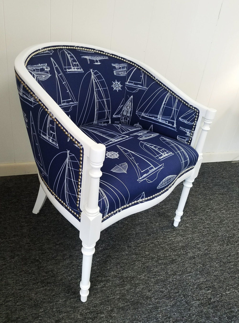 After all repairs were made, and the interior of the cushion and springs replaced, this sleek Captain-style chair was recovered in a favorite fabric and guaranteed for life.  Check out our  blog  to see the whole process of the nautical chairs!
