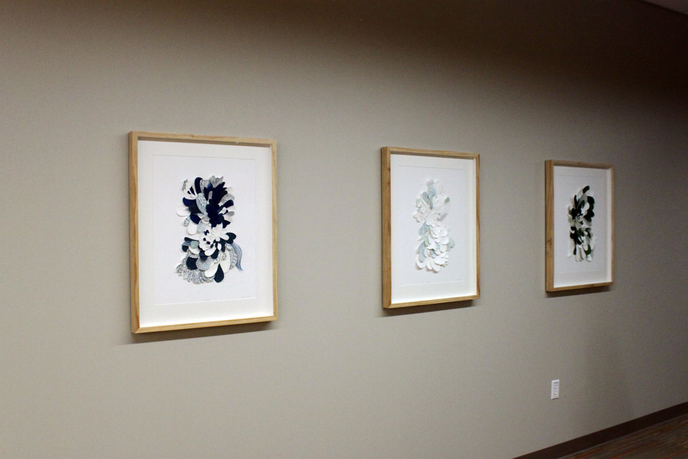 "Installed at Carle Field Administration Building, Champaign, IL First Floor Lobby   Megan Hinds   Left : To Observe  Middle: To Search  Right: To Understand  Intaglio, monotype, hand cut collage   24"" x 2"" x 30""   2018"