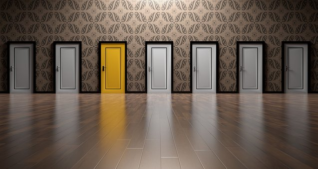 a row of grey doors with a yellow one near the middle - how to choose your Fibromyalgia ME CFS Practitioner