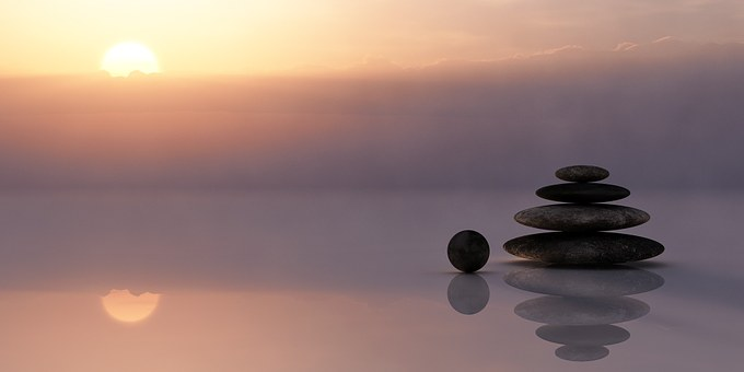Balanced stones at misty sunset - finding balance in life