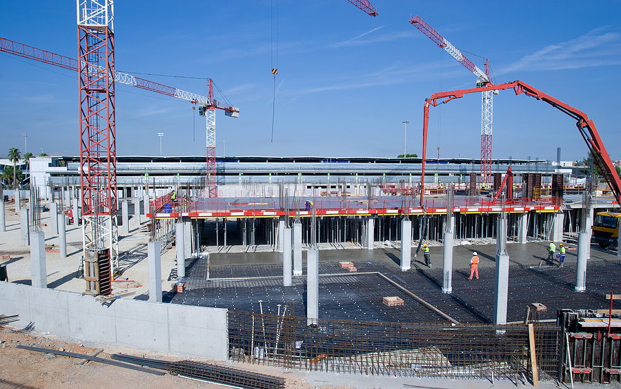 bigstock-Construction-Site-with-Cranes-18512663.jpg
