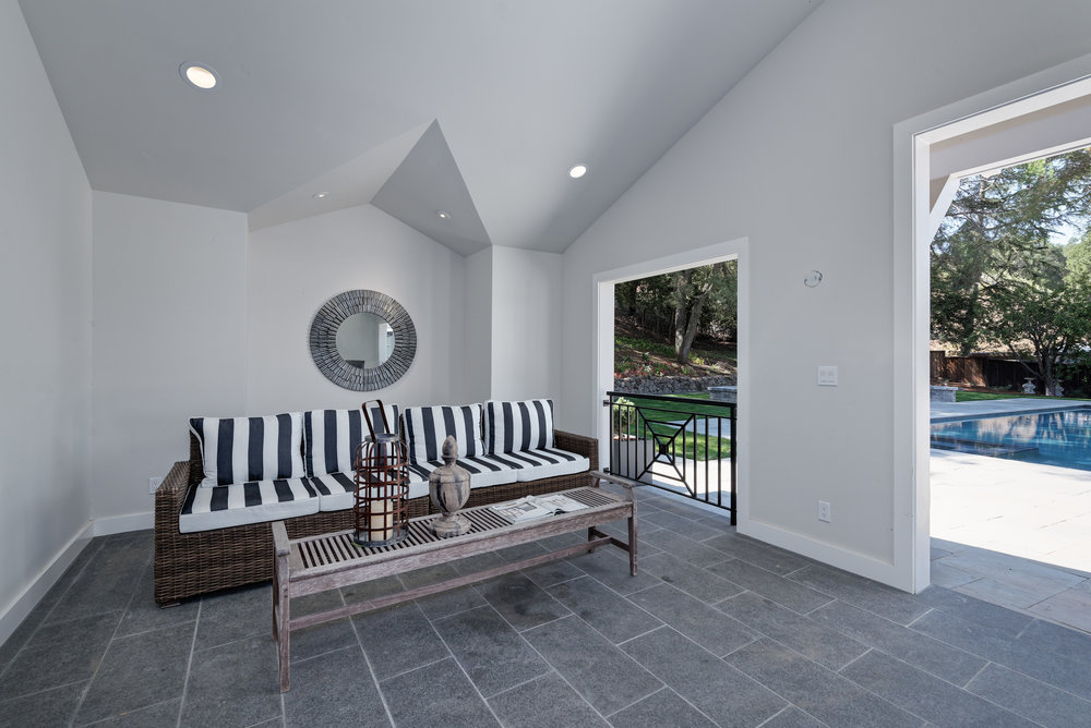poolhouse couch towards pool.jpg