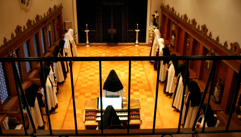 - Nuns in the choir, wearing mantles and praying the Divine Office. Maybe one of them is the hebdomadary.