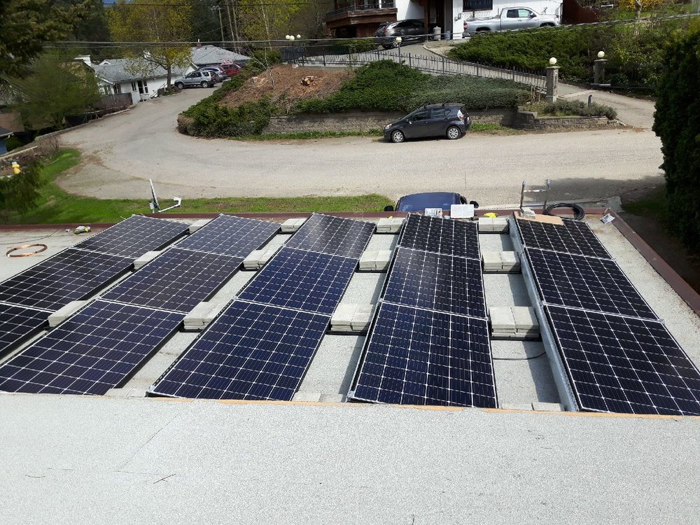On A Flat Roof - Mounting solar modules on flat roofs is easy, and many commercial (and more recently residential) projects are done using a ballasted, non-penetrating option called the EcoFoot2 rack. These racks are weighted down with concrete blocks and are rail-free.