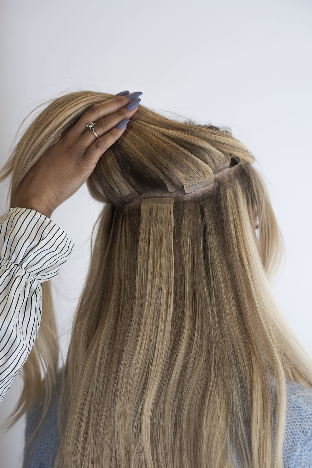 TAPE-IN EXTENSIONS ARE RE-USABLE AND LAY FLAT TO YOUR HEAD. - Extensions by Bailee, styling by Nicole S. and Tivona.