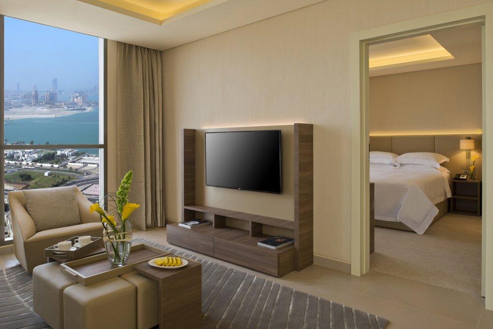 fraser_suites_west_bay_1_bedroom_apartment_(living_room___master_bedroom).jpg