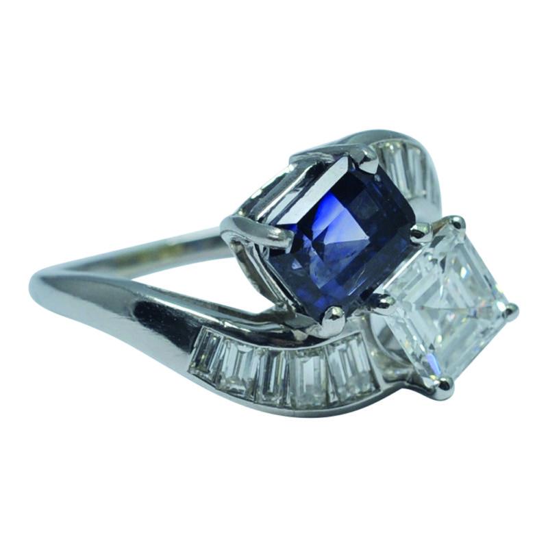 HR PLAZA DIAMOND-SAPPHIRE-XOVER-RING cmyk.jpg