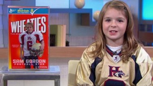 Screen shot from ESPN of Sam Gordon seeing her Wheaties box
