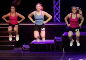 Alysse Blight (center) performs in the fitness portion of the Distinguished Young Women of America National Scholarship Program contest.
