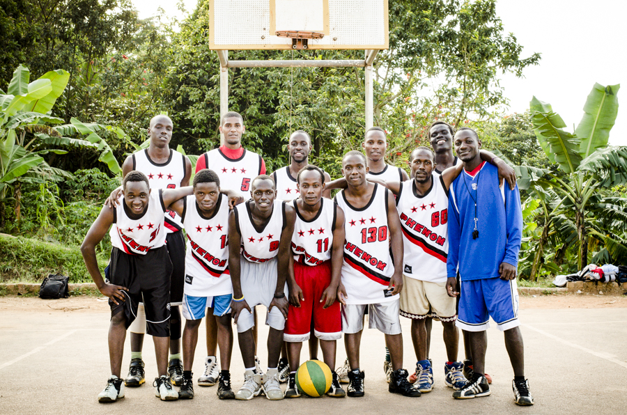 Team Phenom poses for a picture on their home court. This team was launched by the dream of two high school student athletes who wanted to combine their love of the game with their desire to help disadvantaged communities. Team Phenom strives to create opportunities for young men and women and has opened the door to college scholarships and a personal work ethic and drive to succeed.   Mukono, Uganda