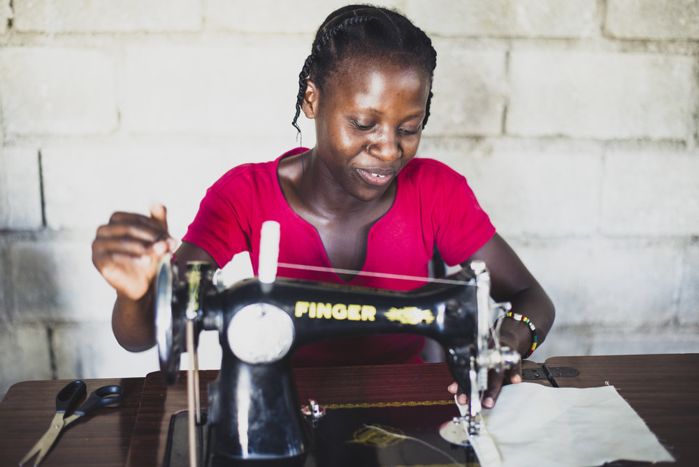 A new student in the Threads of Hope Program learns to use a sewing machine for the first time. This 18 month program started with the goal of providing vocational skills and training in business practices to young men and women at an orphanage in Haiti. It has since expanded into Uganda. Bags and aprons are available for purchase, providing a means of income for the students and also a small micro loan upon graduation.   Croix des Bouquets, Haiti