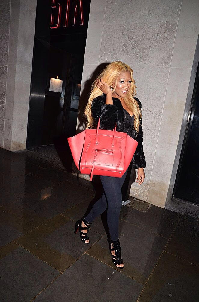 papped + stylish + fur + patent black high top + louboutins + celine bag red + gina rio + georgina rio + hot + body + uk + style + outfit + blogger + vlogger + london.jpg