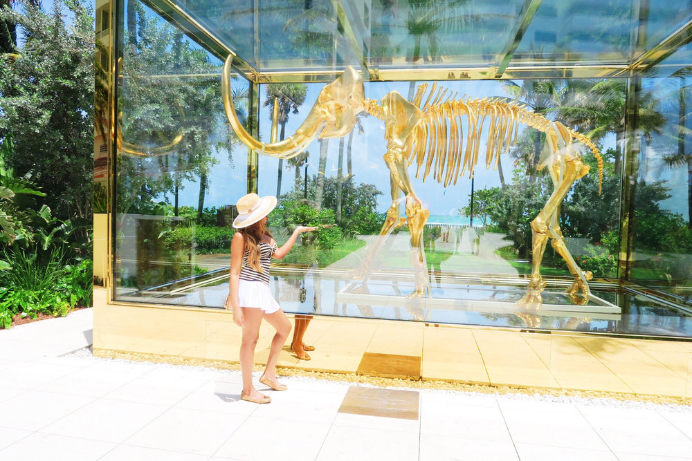 damien hirst + gold mammoth + faena hotel + miami beach + review + luxury hotel + holiday + stay + 5 star miami hotel + family + gina rio + gerogina rio  + big boobs + hot + beach look + pool side + outfit + bikini.jpg