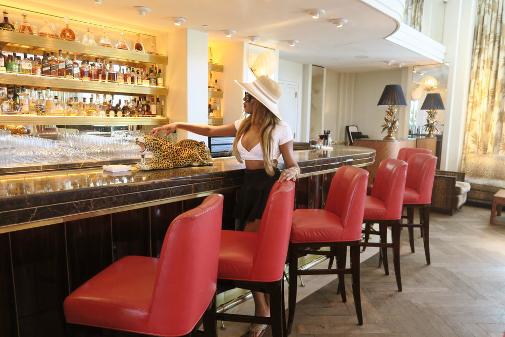 bar + faena hotel miami beach + luxury + millionaires + billionaires + wealth + style + fashion + sexy look + beach hat .jpg