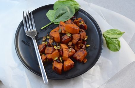 pan-roasted sweet potato with cranberries and pepitas