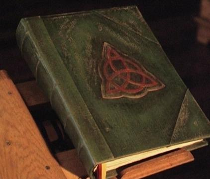 The Triquetra on the Book of Shadows, a magical tome from  Charmed .     422 × 360 Image may be subject to copyright