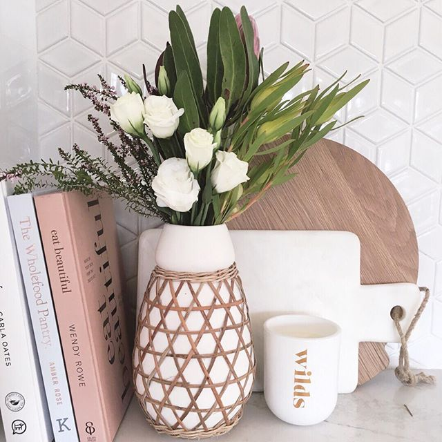 When styling a kitchen I love creating layers. Using items like paddle boards, cookbooks and a vase of fresh flowers can often bring life and interest to a usually dull and cluttered space.