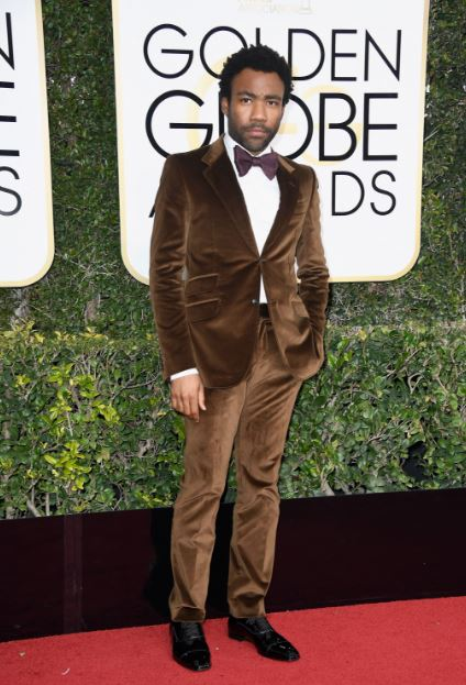 I loved that Donald Glover went with this chocolate, textured suit for the 2017 Golden Globes. The purple bowtie was a beautiful pairing. Suits don't have to be boring!