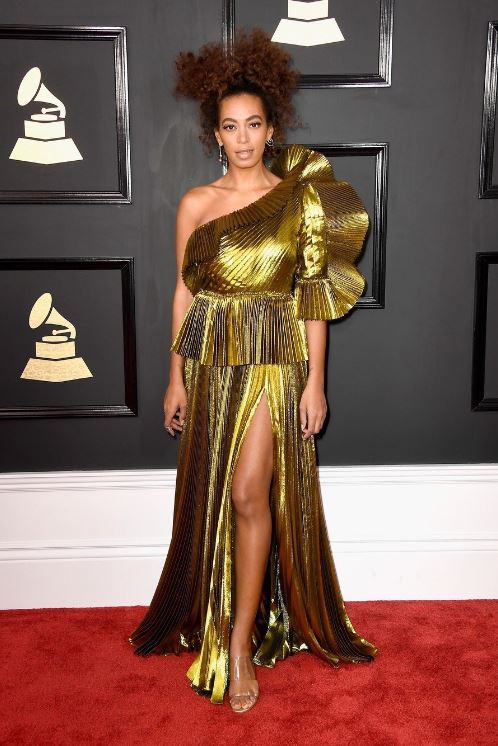 Solange always comes through with ethereal style! At the 2017 Grammys she was all gold in a structured gown with high slit. Don't be afraid to try a new shape to your dresses!