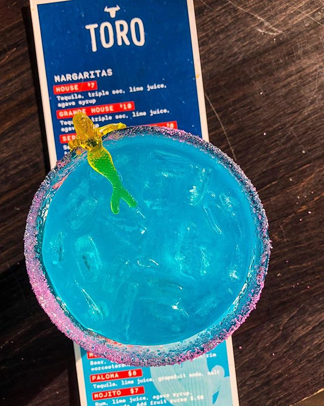We're over here just pretending to sunbathe in a blue margarita ☀️ Raise your hand if you want summer back 🤚!! Happy Hour from 3-6 today (and everyday)! #torobozeman #toro #downtownbozeman