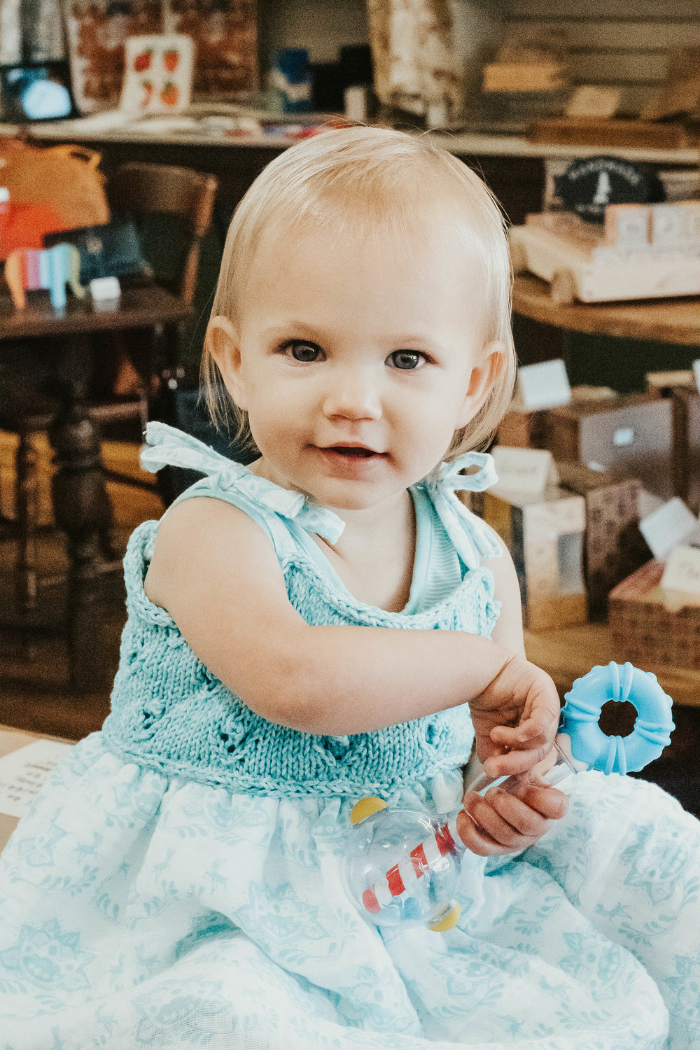 CHILDREN:  Employee Trish's beautiful granddaughter wearing the Toddler Sundress from our June (2018) knitting/crochet class!
