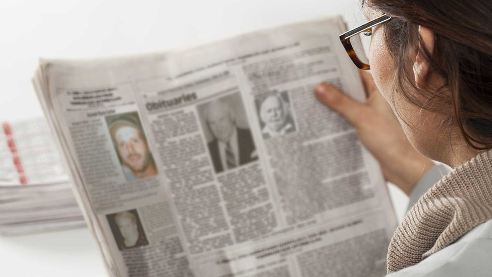 MN-Mom-Reads-Paper-Only-for-Obituaries.jpg