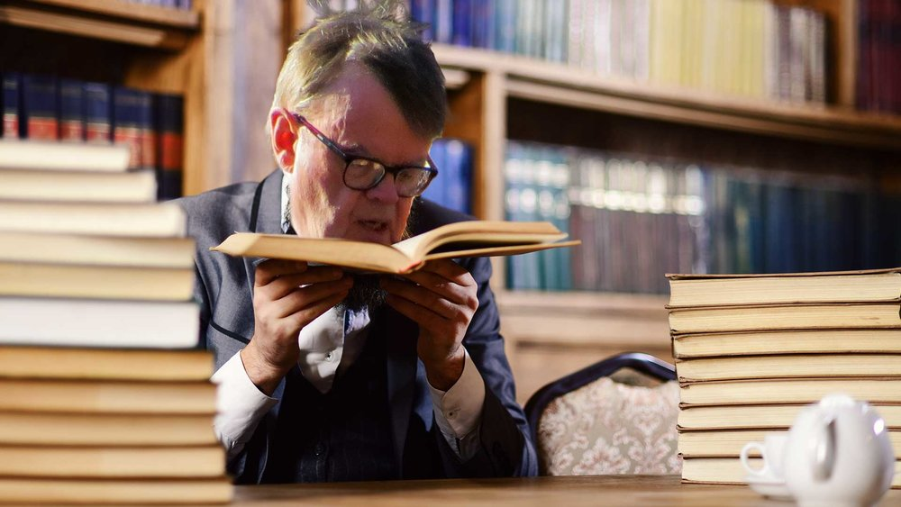 Disgraced-Garrison-Keillor-Found-in-Lake-of-the-Isles-Bookstore-Huffing-Leatherbound-Copy-of-Finnegans-Wake.jpg