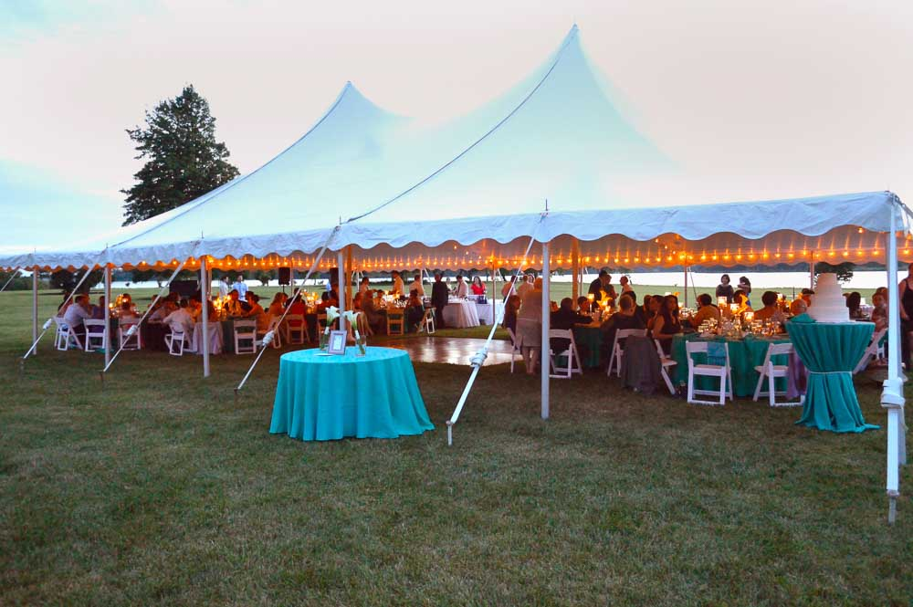 Tent with Teal Linen Tables