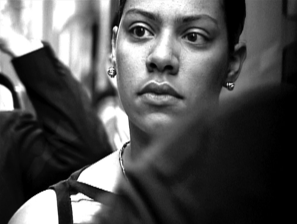 Exchange  2003 | B&W digital video | 2003   Set to a percussive soundtrack by composer Scott Lindroth, the film visualizes the collective psyche of white-collar Wall Street workers seen on their way to work in the first summer of the post-9/11 universe, their eyes betraying an underlying disquiet.    More about Exchange