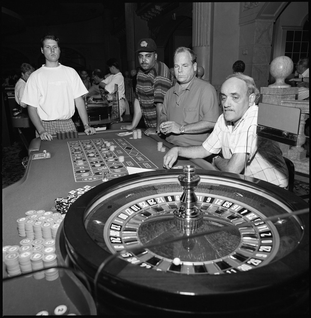 Casino   Emotionally empty slots, card and table players, sometimes briefly uplifted, more often marked by a dulled weariness.