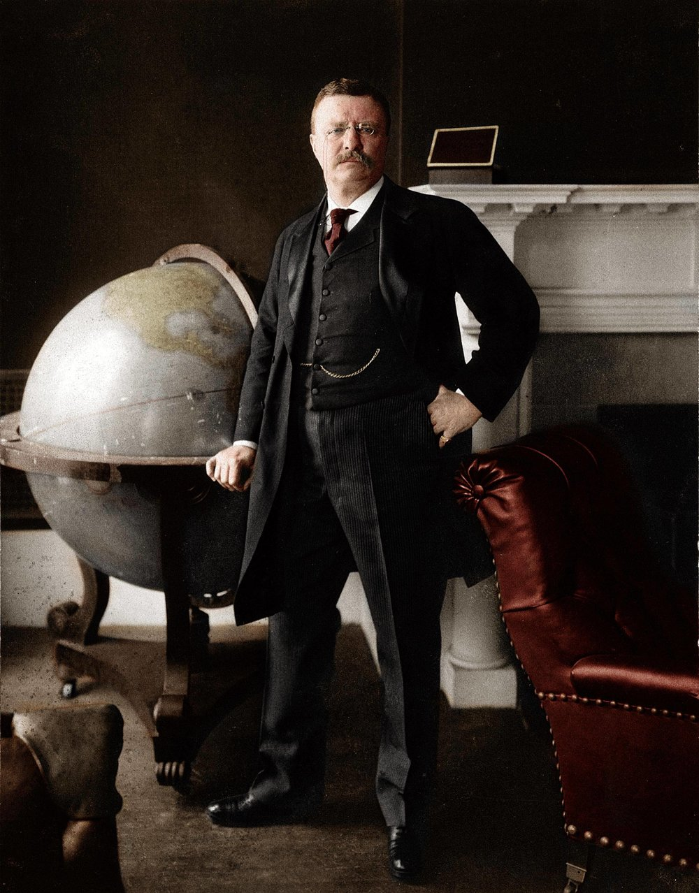 Theodore Roosevelt posing with a world globe on the 24 February 1903. Colorization by  Xander-Lionheart