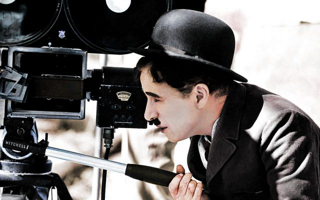 Actor Charlie Chaplin looks though a movie camera on the 22 April 1935.