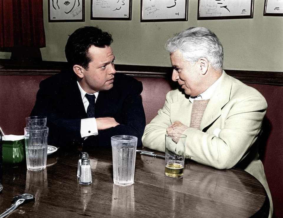 Orson Welles, famous American actor, and Charlie Chaplin having lunch together at the Brown Derby in Hollywood in March 1947