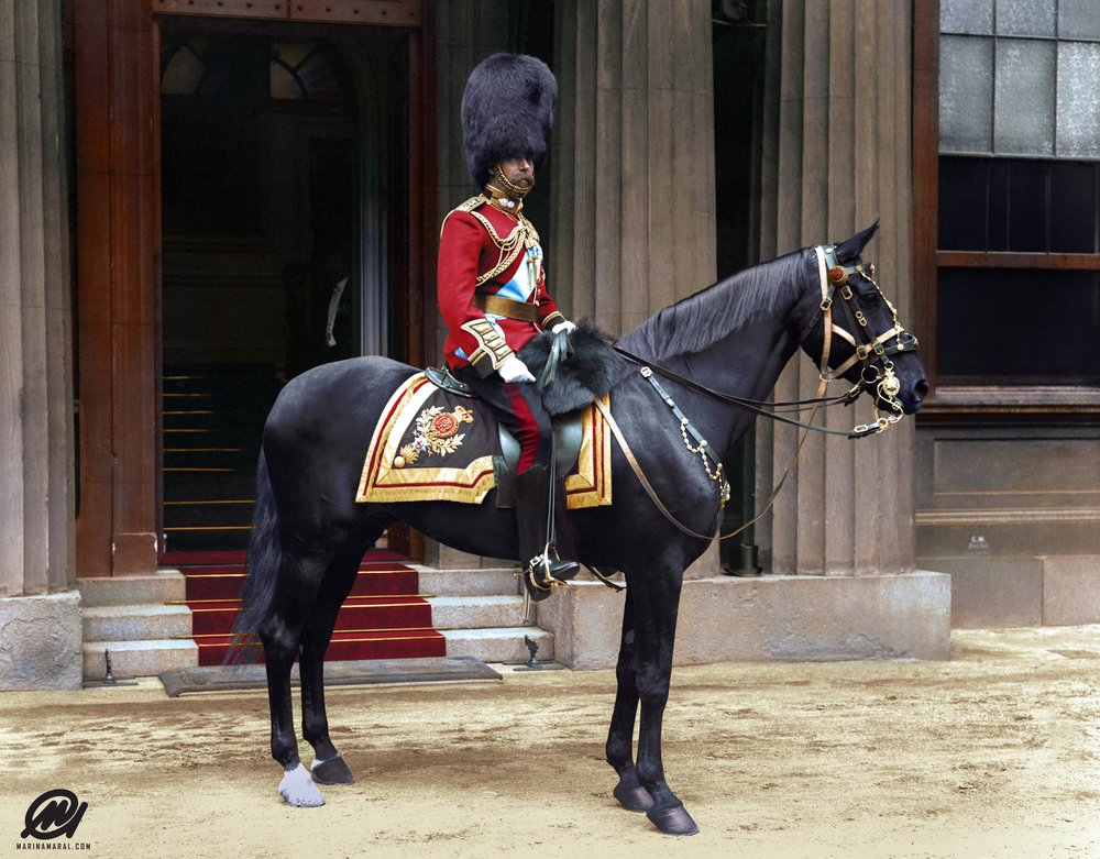 Photograph of King George V on a horse in uniform at Buckingham Palace in 1914.