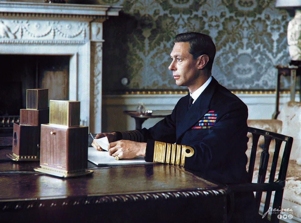 A staged photograph of George VI addressing the nation in his first Radio Broadcast after the Declaration of War against Germany in September 1939.