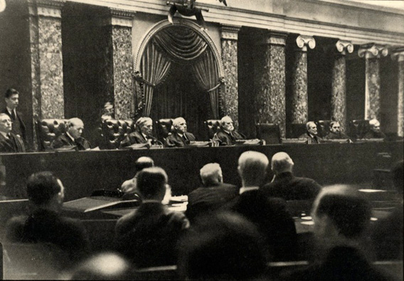 This photograph, taken by Erich Salomon, shows one of only two known photographs taken of the US Supreme Court whilst it is in session as cameras have been banned from the court. This image was taken in 1932.