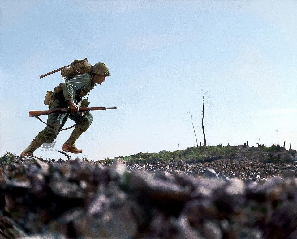 Photograph of a US Marine running through Japanese fire in Okinawa, Japan on 7 June 1945. Colorization by  Marina Amaral .