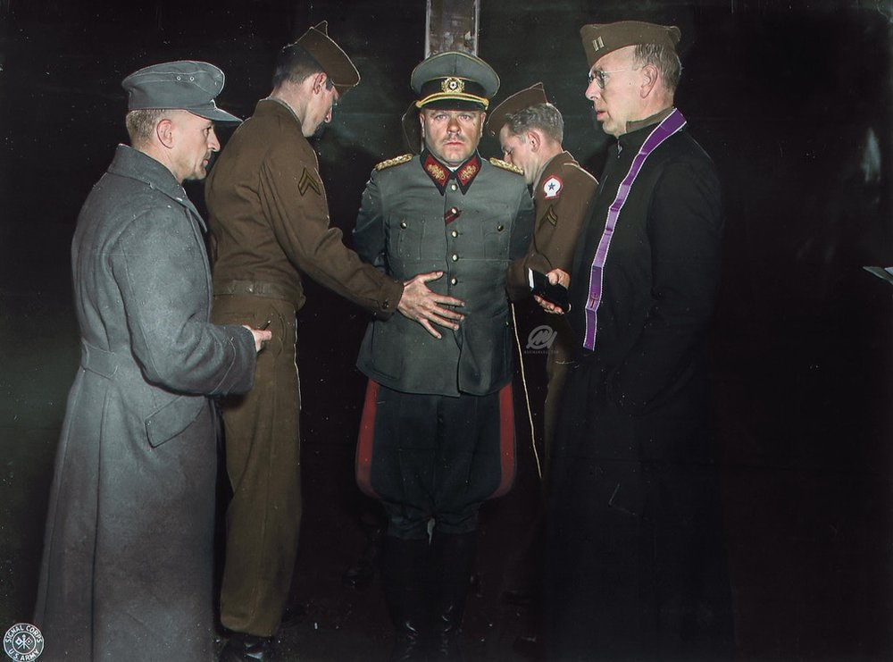Photograph of two American soldiers preparing Major General Anton Dostler for Execution in Italy, 1945