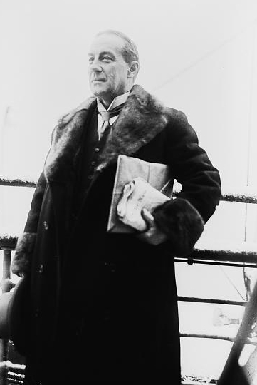 Prime Minister Stanley Baldwin wearing a fur coat on a ship.
