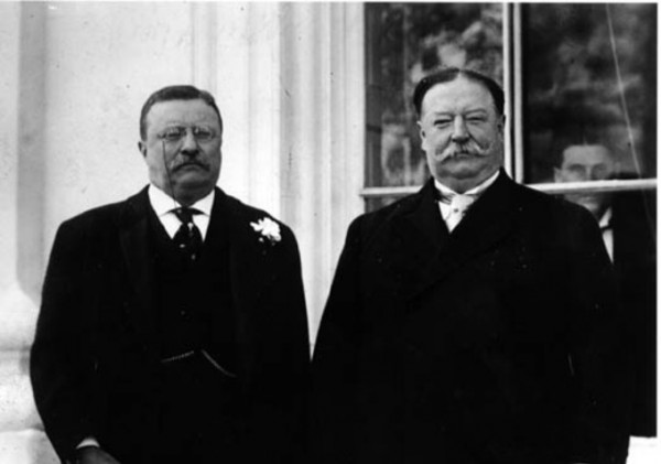 Theodore Roosevelt and William Howard Taft standing together. Taft was originally Roosevelt's recommendation for President but they became rivals in the 1912 Presidential Election.