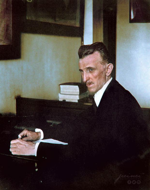 Nikola Tesla sitting at a desk in his office in New York City, USA in 1916. Colorization by  Jecinci