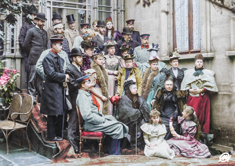A color photograph of Queen Victoria with many members of her family at a wedding in 1894. The photograph also features future King Edward VII of the United Kingdom, future Tsar Nicholas II of the Russian Empire and Kaiser Wilhelm II of the German Empire. Colorization by  Marina Amaral