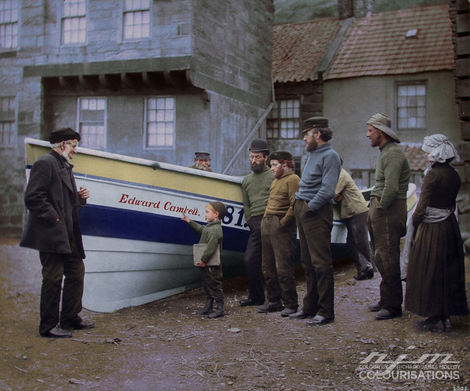 A child with his family, looking at a boat known as 'Edward Campbell' in Whitby, Yorkshire, England sometime in the 1880s. Photograph taken by Frank Meadow Sutcliffe and was turned into color by  ColourbyRJM