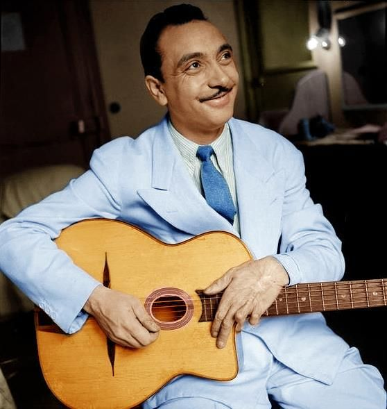 A photograph of Jazz musician, Django Reinhardt in color in c. 1940. This photo was colored through the process of colorization.