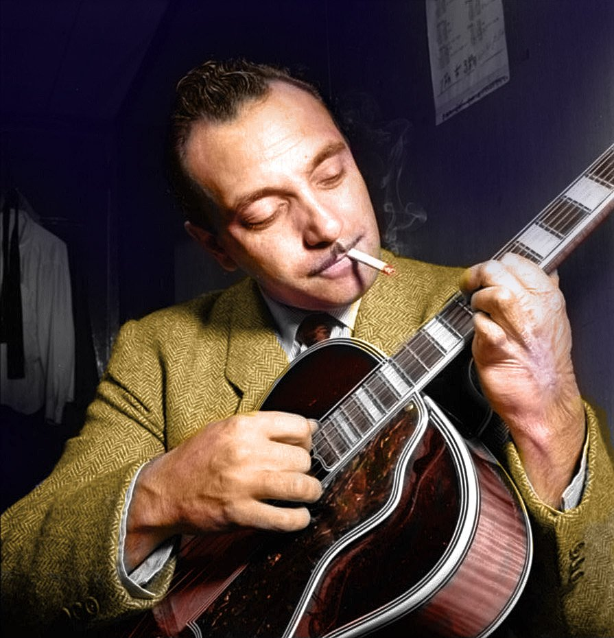 A smoking Django Reinhardt playing the guitar in 1946 at the Aquarium jazz club in New York. Colorization by Reddit User  A_complete_idiot