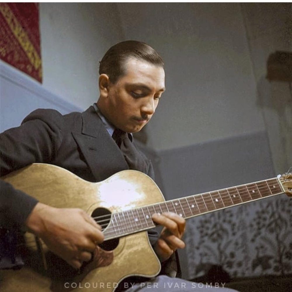 A younger Django Reinhardt playing the guitar with two of his fingers on his left hand. Colorization by  Per Ivar Somby