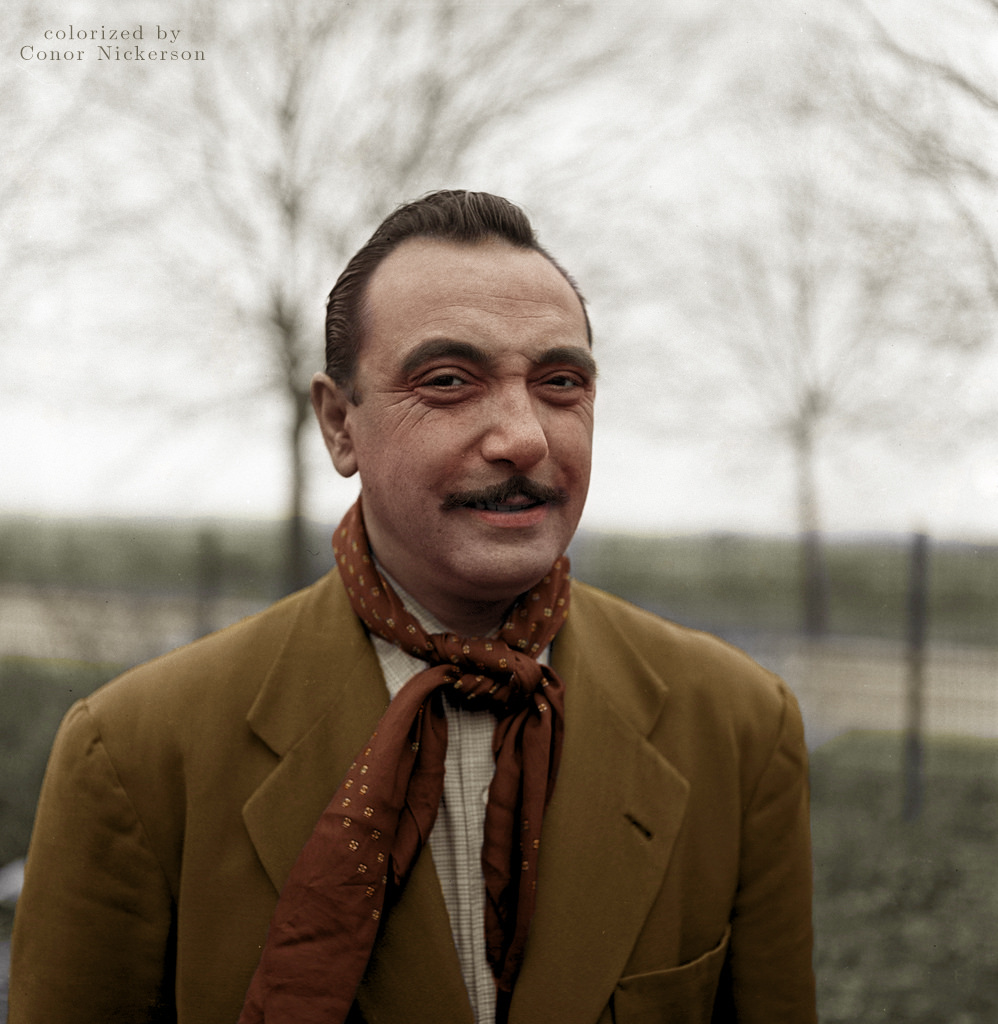 A photograph of Django Reinhardt outside at the age of 40 in 1950. Colorization by  Conor Nickerson