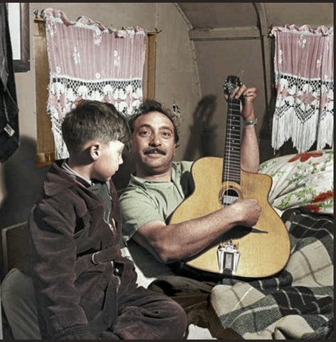 Django with his second son, Babik Reinhardt, in the 1950s. Babik went on to become a guitarist like his father. Colorization by  Per Ivar Somby